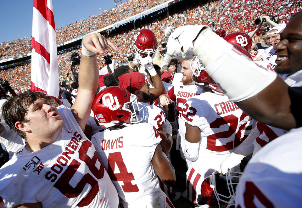 Record - Oklahoma's Creed Humphrey (Fifty six) celebrates following the Crimson River Showdown college football sport between the University of Oklahoma Sooners (OU) and the Texas Longhorns (UT) at Cotton Bowl Stadium in Dallas, Saturday, Oct. 12, 2019. OU gained 34-27. [Sarah Phipps/The Oklahoman]
