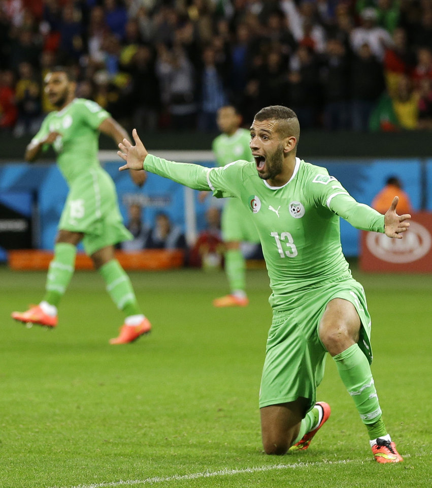 Photo - Algeria's Islam Slimani pleads to the referee for a call on a play during the World Cup round of 16 soccer match between Germany and Algeria at the Estadio Beira-Rio in Porto Alegre, Brazil, Monday, June 30, 2014. (AP Photo/Kirsty Wigglesworth)