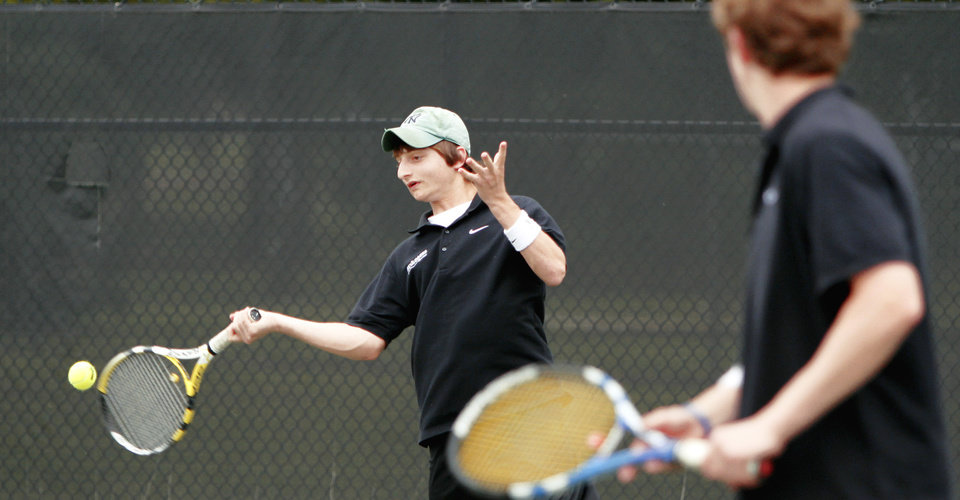 Photo - Bishop McGuinness Jonathan Kraft, left, and John Byrne compete in the state tennis tournament on Saturday. Photo by Bryan Terry, The Oklahoman