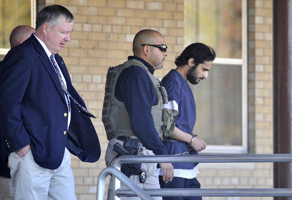 Photo -   CORRECTS NAME TO KHALID ALI-M ALDAWSARI, NOT KHALID ALI-ALDAWSARI - Khalid Ali-M Aldawsari, 22, right, is escorted from the federal courthouse in Amarillo, Texas by U.S. Marshals Tuesday Nov. 13, 2012 after being sentenced to life in prison on a federal charge of attempting to use a weapon of mass destruction in a Lubbock-based bomb-making plot. (AP Photo/Amarillo Globe-News, Michael Schumacher) MANDATORY CREDIT; MAGS OUT; TV OUT;