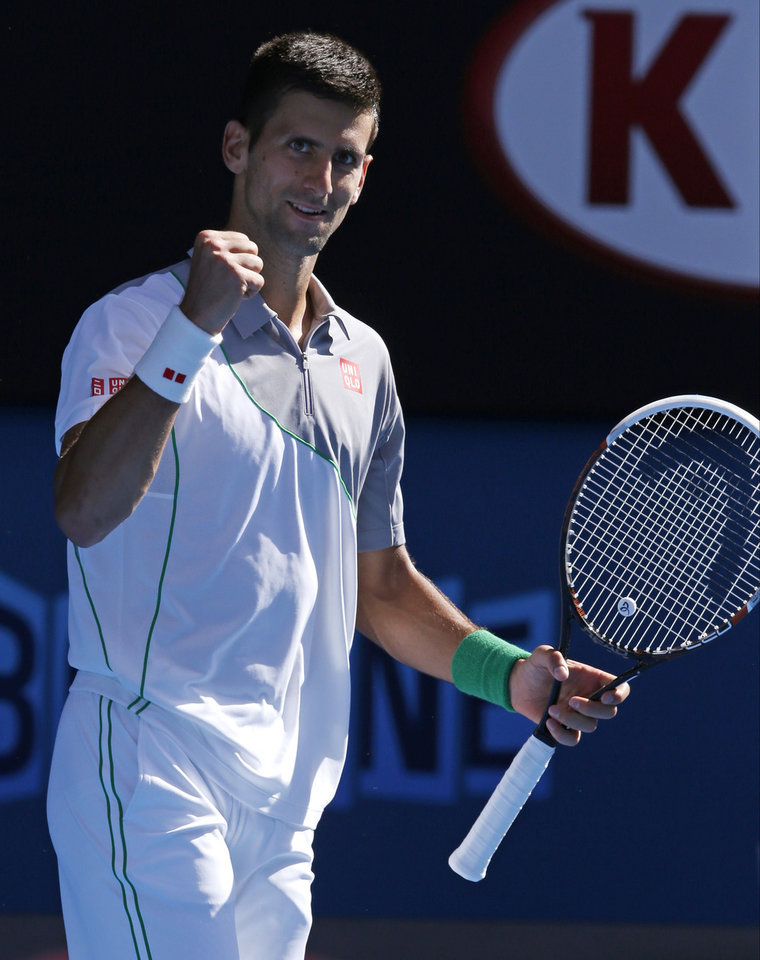 Photo - Novak Djokovic of Serbia celebrates his win over Fabio Fognini of Italy during their fourth round match at the Australian Open tennis championship in Melbourne, Australia, Sunday, Jan. 19, 2014.(AP Photo/Eugene Hoshiko)