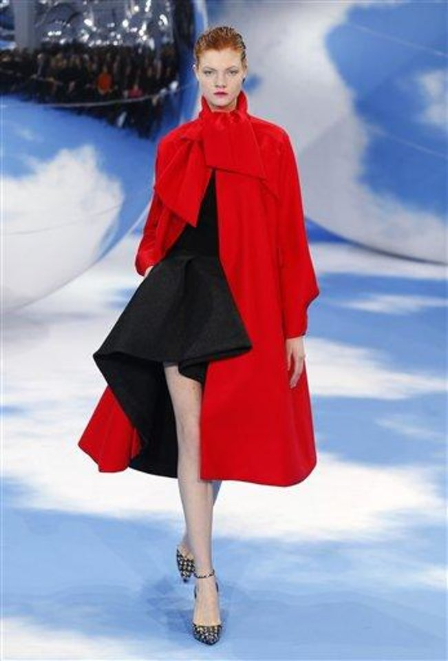 A model wears a creation designer by Raf Simons for Christian Dior's Ready to Wear Fall-Winter 2013-2014 fashion collection, presented, Friday, March 1, 2013 in Paris. (AP Photo/Jacques Brinon)