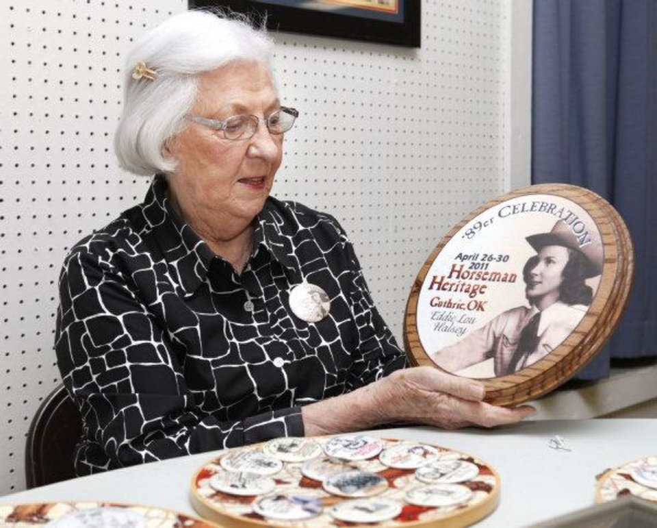 Photo - Eddie Lou Halsey holds a plague that will be auctioned during 89er Day festivities in Guthrie. The plaque bears a picture of her in 1939, the year she was 89er Queen. It is fashioned after this year's 89er Day button. PHOTO BY PAUL HELLSTERN, THE OKLAHOMAN