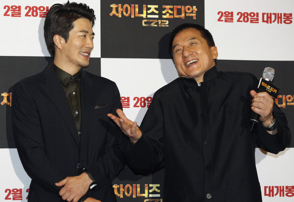 Photo - CORRECTS YEAR - Hong Kong actor and director Jackie Chan, right, and South Korean actor Kwon Sang-woo smile during a promotional event for their latest movie, CZ12, or Chinese Zodiac, in Seoul, South Korea, Monday, Feb. 18, 2013. (AP Photo/Ahn Young-joon)
