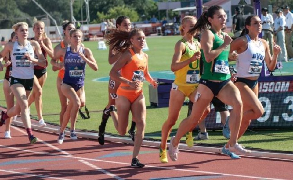 Photo -  Oklahoma State runner Sinclaire Johnson (in orange) went into the finals of the 1,500 meters at NCAAs with a plan -- answer every move from defending champion Jessica Hull (in yellow). Johnson went stride for stride with Hull until the final 50 meters when Johnson broke away and won by .29 seconds. [OSU ATHLETICS]