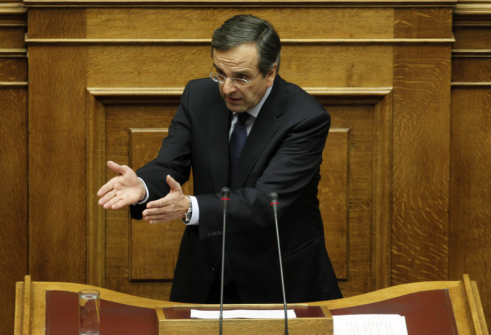Conservative opposition leader Antonis Samaras speaks during a parliament session in Athens, Thursday, Nov. 3, 2011. Samaras called on the prime minister to resign and led his party in a dramatic walkout during a parliamentary debate about the viability of the government. (AP Photo/Petros Giannakouris) ORG XMIT: XPG111