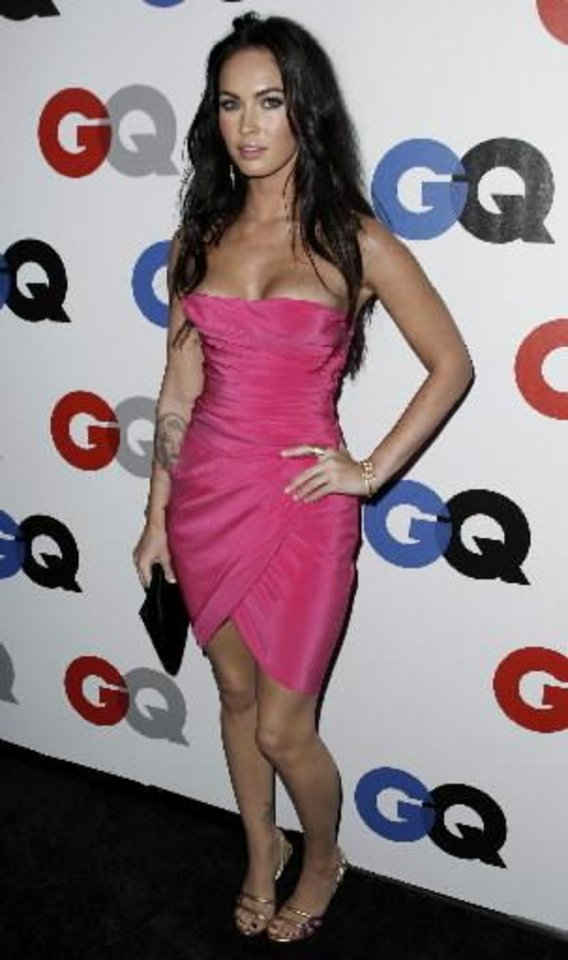 """Photo -  Megan Fox arrives at the GQ magazine 2008 """"Men of the Year"""" party in Los Angeles on Tuesday, Nov. 18, 2008. (AP Photo/Matt Sayles)"""