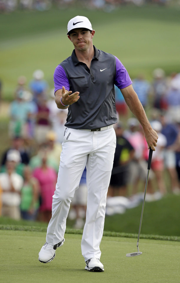 Photo - Rory McIlroy, of Northern Ireland, reacts to his missed putt on the first hole during the final round of the PGA Championship golf tournament at Valhalla Golf Club on Sunday, Aug. 10, 2014, in Louisville, Ky. (AP Photo/John Locher)