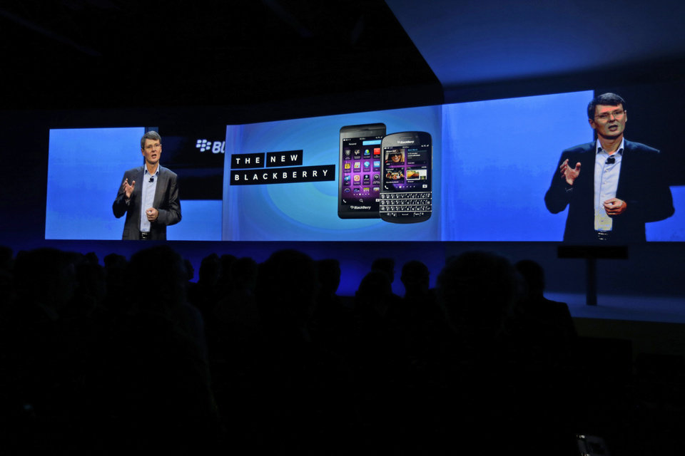 Photo - BlackBerry's CEO Thorsten Heins is seen on a screen on a live broadcast from a launch event in New York of the new smartphones of the company, during a launch event in London, Wednesday, Jan. 30, 2013. The first in a new generation of long-awaited BlackBerrys will go on sale in the next week in Canada and the United Kingdom, but won't be released in the U.S. until March.(AP Photo/Lefteris Pitarakis)