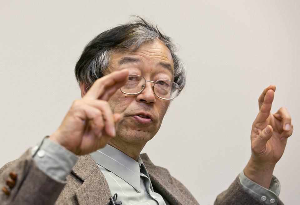 Photo - Dorian S. Nakamoto gestures during an interview with the Associated Press, Thursday, March 6, 2014 in Los Angeles. Nakamoto, the man that Newsweek claims is the founder of Bitcoin, denies he had anything to do with it and says he had never even heard of the digital currency until his son told him he had been contacted by a reporter three weeks ago. (AP Photo/Damian Dovarganes)