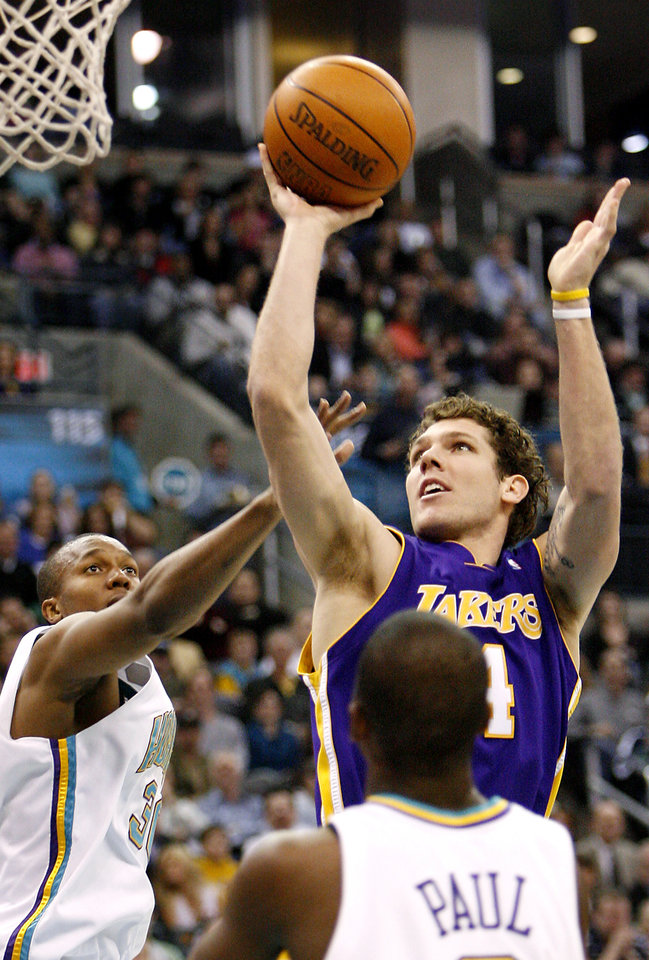 Photo - Los Angeles Lakers forward Luke Walton (4) shoots the ball as New Orleans/Oklahoma City Hornets forward David West (30) and Chris Paul (bottom right) look on in the first half of Saturday night's NBA basketball game Feb. 4, 2006 in Oklahoma City. (AP Photo/Ty Russell)