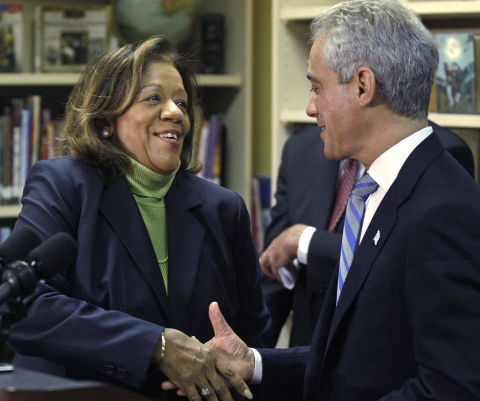 "Newly appointed Chicago Public Schools CEO Barbara Byrd-Bennett, shakes hands with Chicago Mayor Rahm Emanuel at a news conference, Friday, Oct. 12, 2012, in Chicago. Emanuel replaced his embattled public schools chief Jean-Claude Brizard with Bennett, a veteran educator and administrator whose experience in Cleveland, Detroit and New York will help take Chicago school reforms ""to the next level."" (AP Photo/M. Spencer Green)"