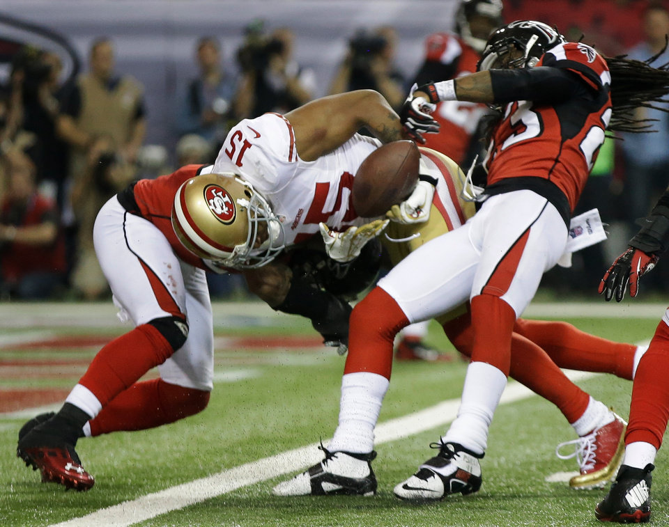 Atlanta Falcons' Dunta Robinson strips the ball from San Francisco 49ers' Michael Crabtree during the second half of the NFL football NFC Championship game Sunday, Jan. 20, 2013, in Atlanta. The Falcons recovered the fumble. (AP Photo/Mark Humphrey)