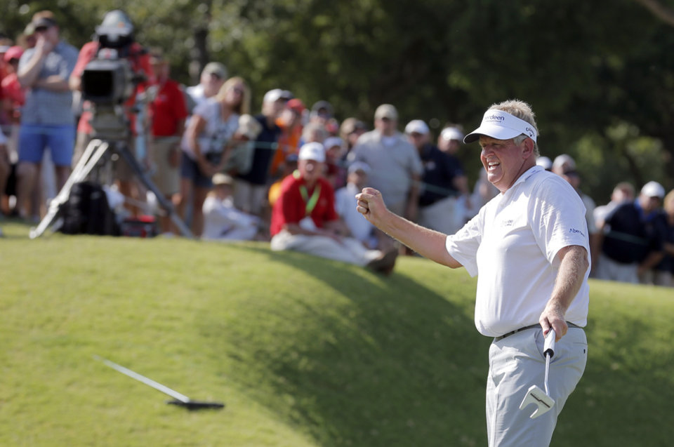 Photo - Colin Montgomerie celebrates his putt on the 18th hole during a 3-hole playoff in the final round of the U.S. Senior Open golf tournament at Oak Tree National in Edmond, Okla., Sunday, July 13, 2014. Photo by Sarah Phipps, The Oklahoman