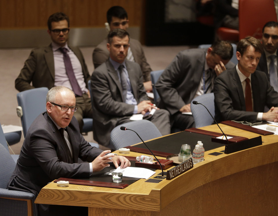 Photo - Dutch Foreign Minister Frans Timmermans, left, speaks during a security council meeting at United Nations headquarters, Monday, July 21, 2014. The council unanimously adopted a resolution demanding full access to the crash site of Malaysia Airlines flight MH17. (AP Photo/Seth Wenig)