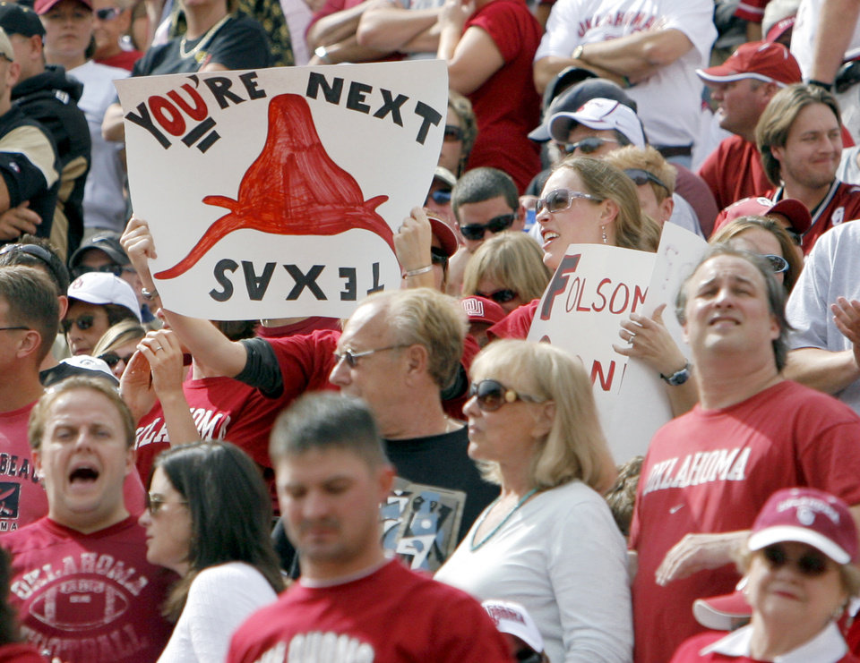 Photo - An Oklahoma fan holds a sign that says
