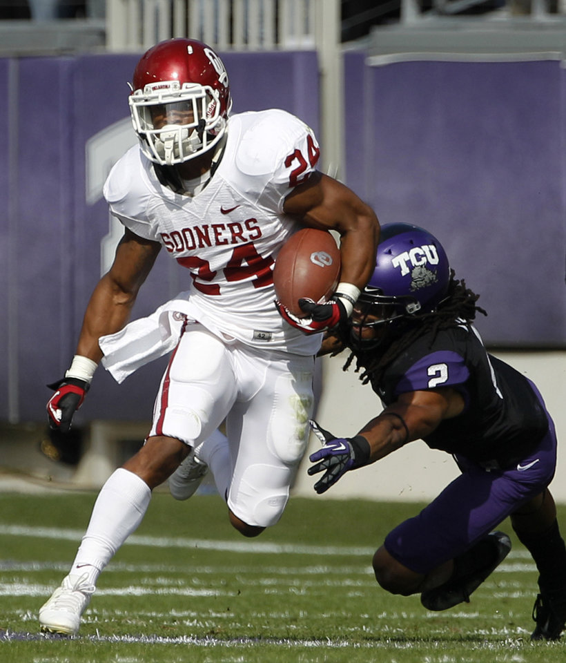 Photo - Oklahoma running back Brennan Clay (24) finds running room as TCU's Jason Verrett (2) attempts the tackle in the first half of an NCAA college football game Saturday, Dec. 1, 2012, in Fort Worth, Texas. (AP Photo/Tony Gutierrez)