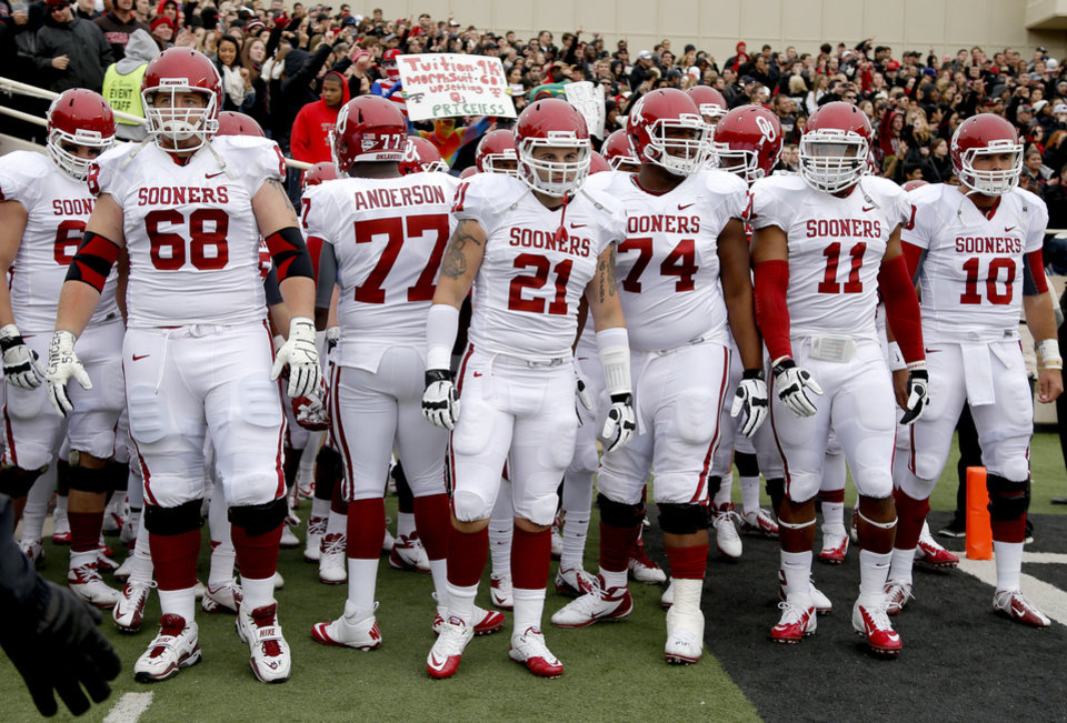 Photo - Oklahoma gets ready to take the field before a college football game between the University of Oklahoma (OU) and Texas Tech University at Jones AT&T Stadium in Lubbock, Texas, Saturday, Oct. 6, 2012. Photo by Bryan Terry, The Oklahoman