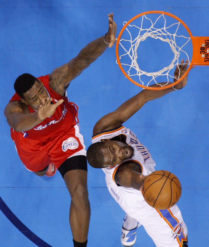 Oklahoma City\'s Kevin Durant (35) goes to the basket beside Los Angeles Clippers\' DeAndre Jordan (6) during an NBA basketball game between the Oklahoma City Thunder and the Los Angeles Clippers at Chesapeake Energey Arena in Oklahoma City, Thursday, Nov. 21, 2013. Photo by Bryan Terry, The Oklahoman