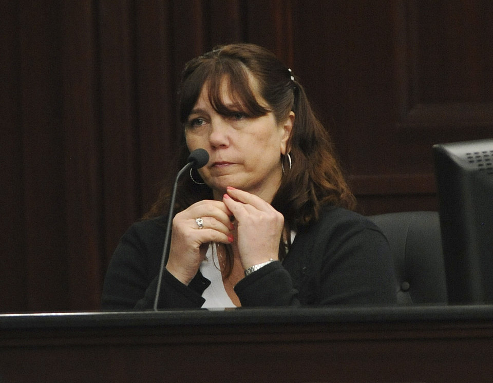Photo - Rhonda Rouer, fiance of Michael Dunn testifies, Tuesday, Feb. 11, 2014 in Jacksonville, Fla. Michael Dunn, the Florida man charged with fatally shooting a 17-year-old boy after an argument over loud music testified Tuesday that he thought he saw the barrel of a gun from a neighboring vehicle pointed at him and that he feared for his life before firing his weapon.  (AP Photo/The Florida Times-Union, Bob Mack, Pool)