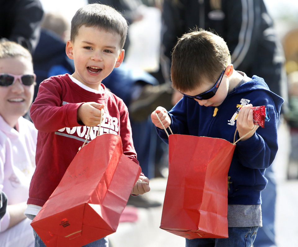 Jaxon Slawson and Cody Lyon, both 4, wait for treats to be hurled their way during the 89er Day Parade on Saturday, April 20, 2013 in Norman, Okla. Photo by Steve Sisney, The Oklahoman