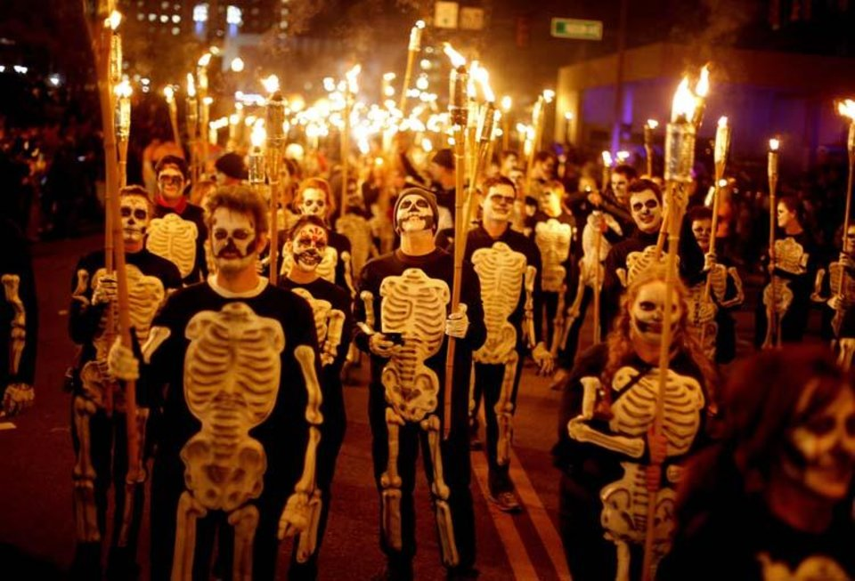 Photo -  People dressed as skeletons march in the March of 1,000 Flaming Skeletons during the Ghouls Gone Wild Halloween Parade in Oklahoma City, Saturday, October 24, 2009. Photo by Bryan Terry, The Oklahoman