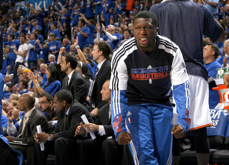 Photo - Oklahoma City's Nate Robinson (3) celebrates on the bench during the first round NBA basketball playoff game between the Oklahoma City Thunder and the Denver Nuggets on Wednesday, April 20, 2011, at the Oklahoma City Arena. Photo by Sarah Phipps, The Oklahoman