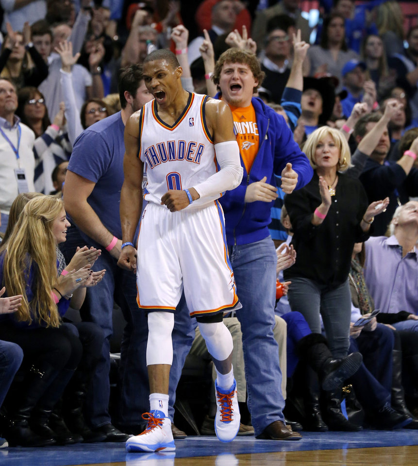 Oklahoma City's Russell Westbrook (0) reacts after a basket during an NBA basketball game between the Oklahoma City Thunder and the Dallas Mavericks at Chesapeake Energy Arena in Oklahoma City, Thursday, Dec. 27, 2012.  Oklahoma City won 111-105. Photo by Bryan Terry, The Oklahoman