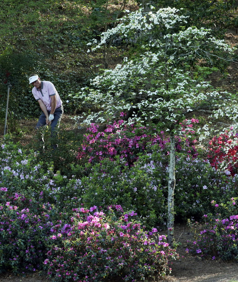 Photo - Russell Henley hits out of rough off the 13th fairway during the first round of the Masters golf tournament Thursday, April 10, 2014, in Augusta, Ga. (AP Photo/Charlie Riedel)