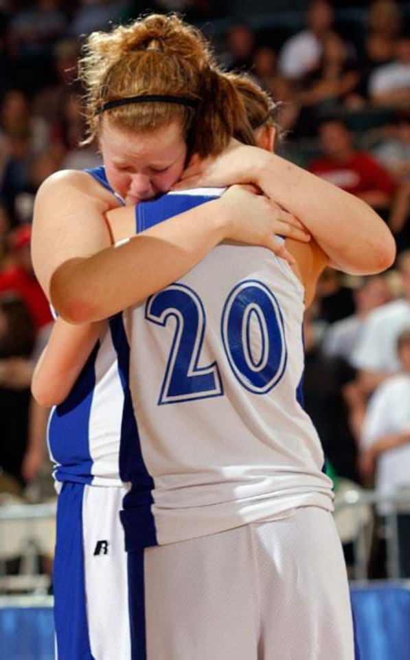 Photo -  Cyril's Shelbi Stallings and Chelsea Reynolds (20) react to Cyril's loss after the girls'  Class B State Basketball finals, Saturday, March 7, 2009, at the State Fair Arena in Oklahoma City . PHOTO BY BRENDA O'BRIAN. THE OKLAHOMAN
