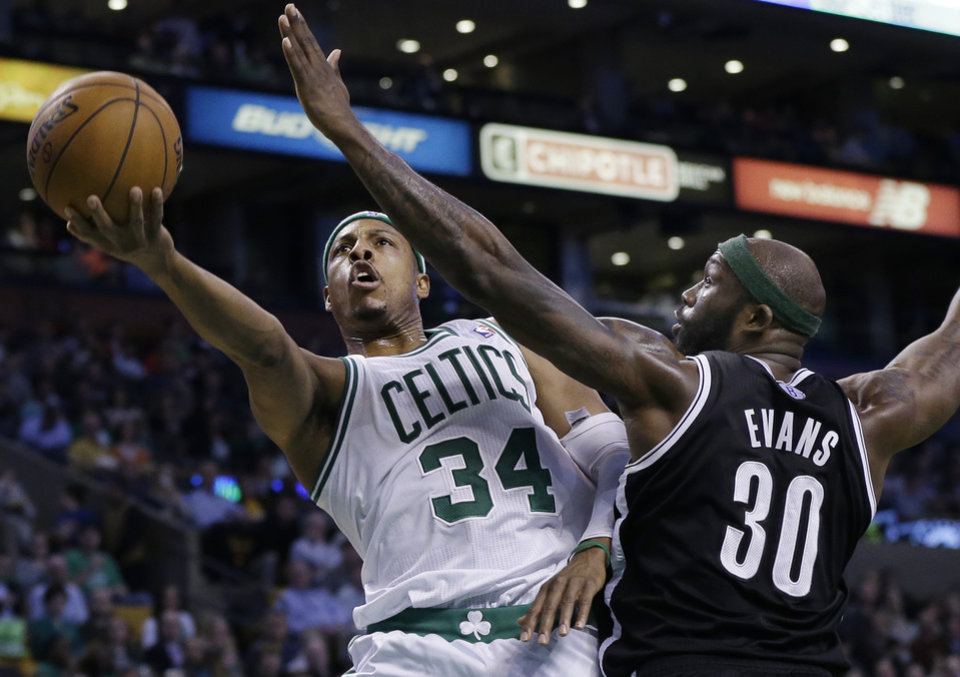 Photo - Boston Celtics forward Paul Pierce (34) lays up the ball against Brooklyn Nets power forward Reggie Evans (30) during the second quarter of an NBA basketball game in Boston, Wednesday, April 10, 2013. (AP Photo/Elise Amendola)