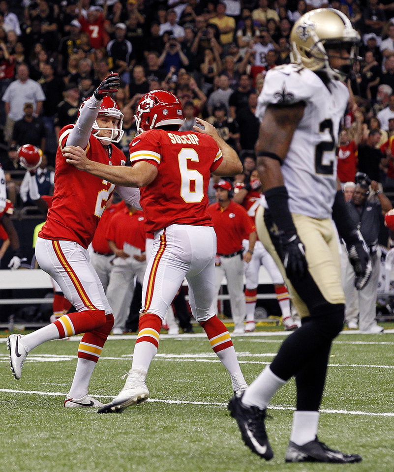 Photo -   Kansas City Chiefs kicker Ryan Succop (6) celebrates his game-winning field goal with holder Dustin Colquitt (2) as New Orleans Saints cornerback Corey White (24) walks past in overtime of an NFL football game in New Orleans, Sunday, Sept. 23, 2012. The Chiefs won 27-24. (AP Photo/Jonathan Bachman)