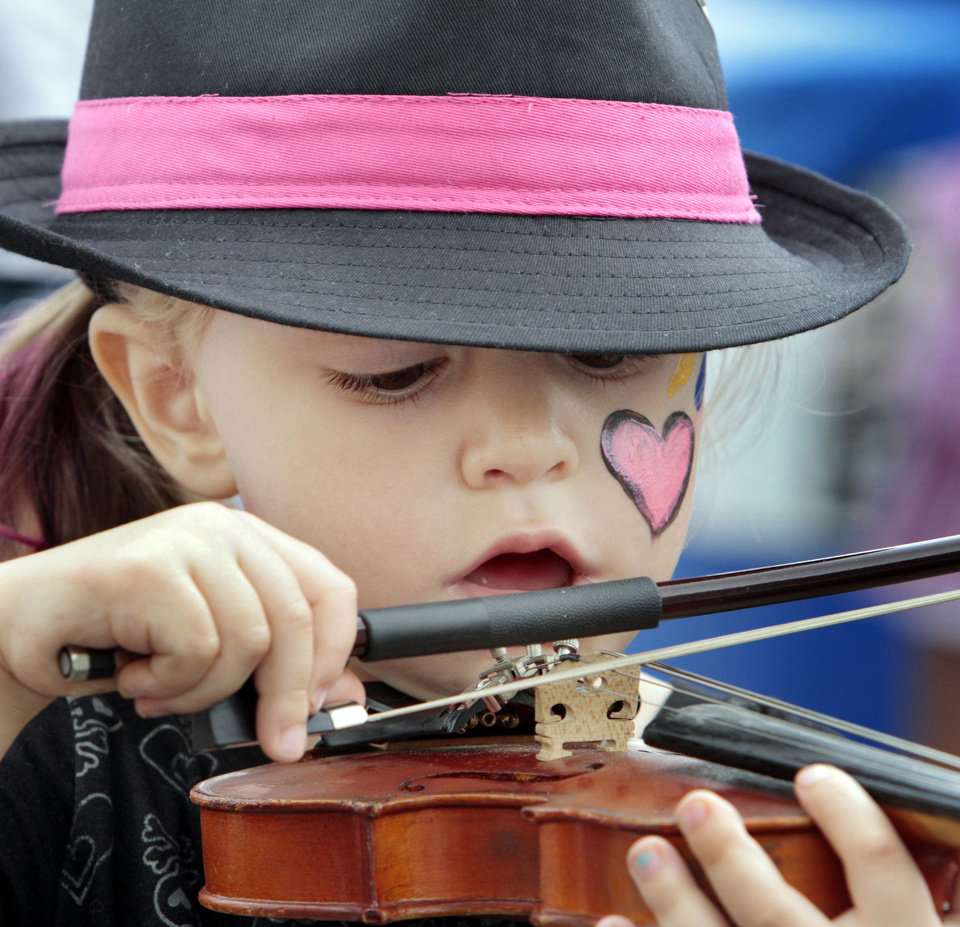Photo - CHILD / KIDS: Skylar Allen, 3, gets to try out a violin during the Norman Music Festival on Saturday, April 28, 2012, in Norman, Okla.  Photo by Steve Sisney, The Oklahoman