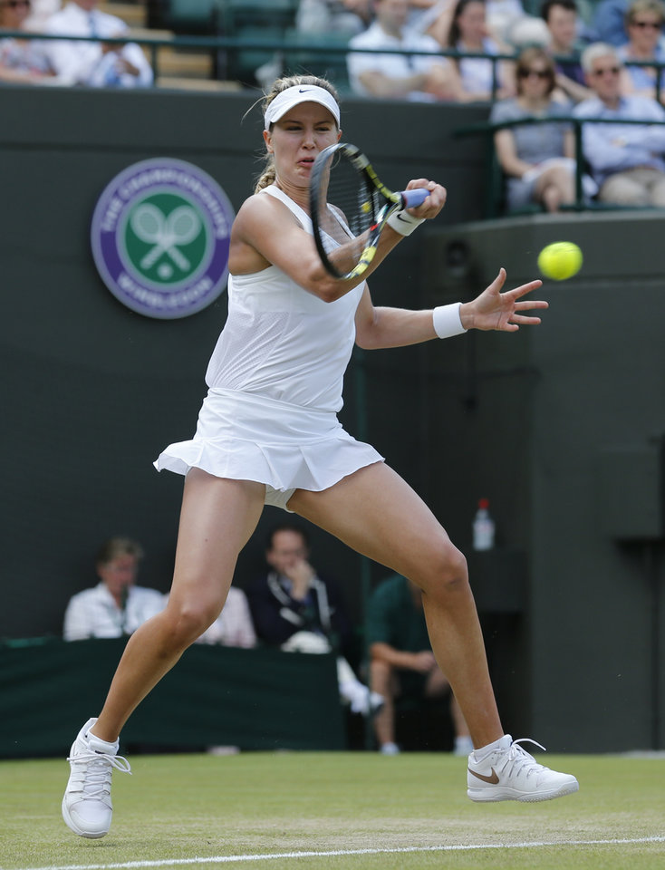 Photo - Eugenie Bouchard of Canada plays a return to Angelique Kerber of Germany during their women's singles quarterfinal match at the All England Lawn Tennis Championships in Wimbledon, London, Wednesday, July 2, 2014. (AP Photo/Ben Curtis)