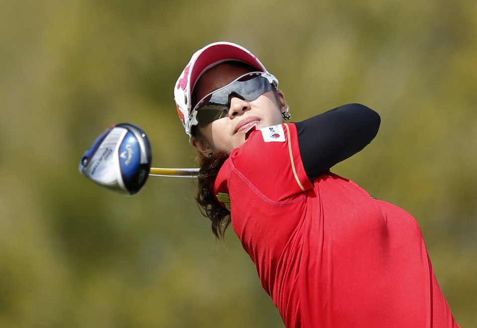 Photo - Pornanong Phatlum, of Thailand, hits her tee shot at the ninth hole during the final round of the LPGA Founders Cup golf tournament on Sunday, March 23, 2014, in Phoenix. (AP Photo/Ross D. Franklin)