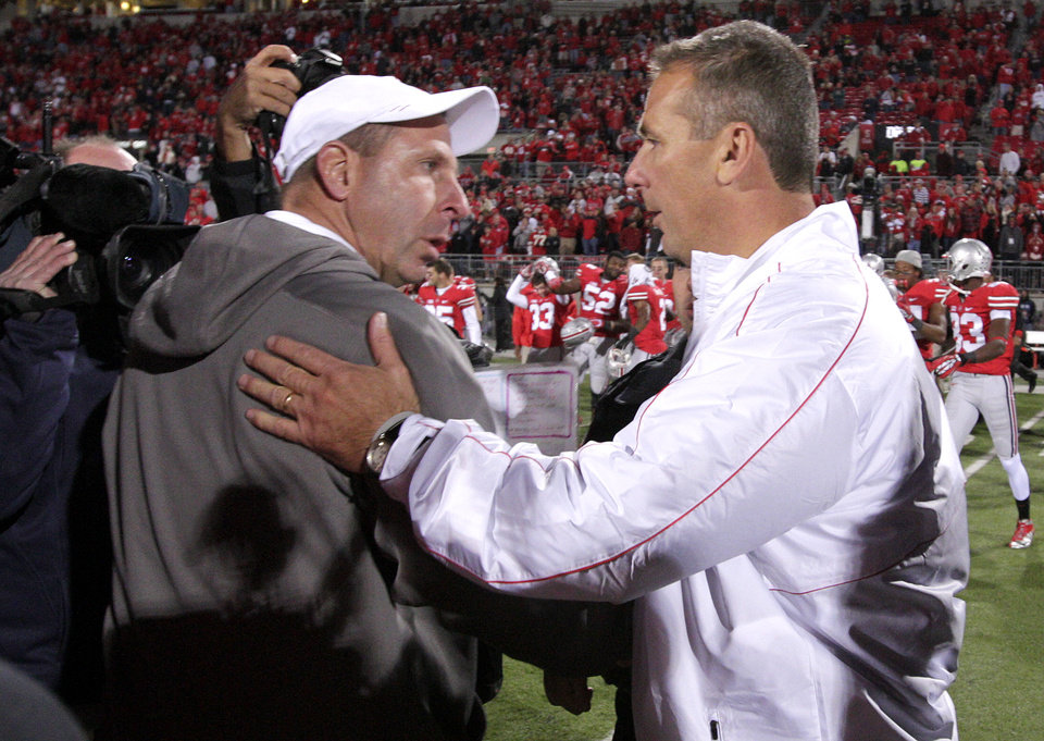 Nebraska head coach Bo Pelini, left, and Ohio State head coach Urban Meyer shake hands after an NCAA college football game, Saturday, Oct. 6, 2012, in Columbus, Ohio. Ohio State defeated Nebraska 63-38. (AP Photo/Jay LaPrete)