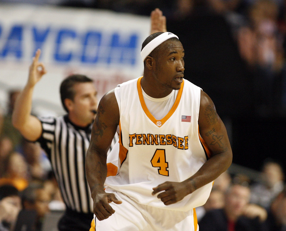 Photo - Tennessee's Wayne Chism transitions to defense after scoring a three-point shot during the first half of a 94-85 win over Auburn in an NCAA college basketball game at the Southeastern Conference men's tournament in Tampa, Fla., March 14, 2009. (AP Photo/Mike Carlson) ORG XMIT: TPA120