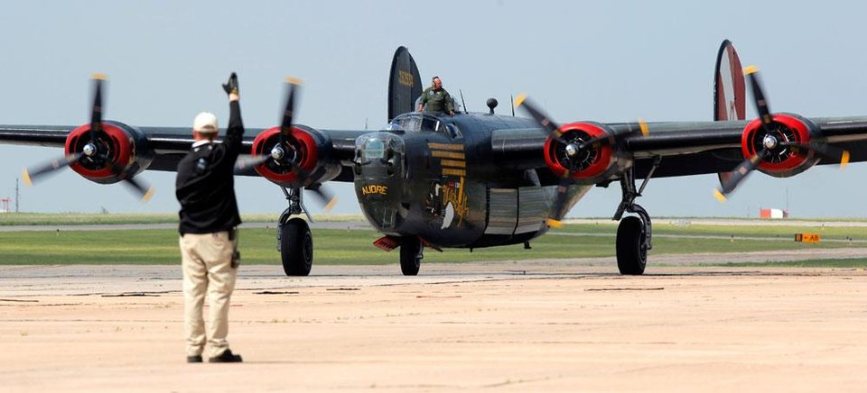 A Consolidated B-24 Liberator taxis after landing at Valair Aviation at Wiley Post Airport as part of the Wings of Freedom Tour in Bethany, Okla., Friday, April 6, 2012. The Wings of Freedom Tour travels the country with vintage World War II aircraft to show the public as a living history display. Photo by Nate Billings, The Oklahoman