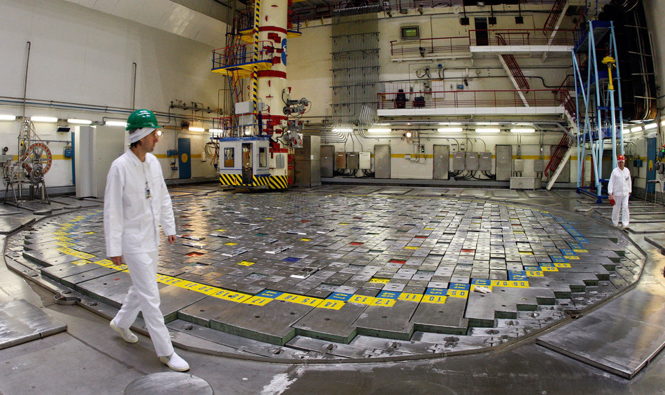 ADVANCE FOR USE SUNDAY, NOV. 18, 2012 AND THEREAFTER - FILE - In this Tuesday, Dec. 15, 2009 file photo, workers walk around Reactor 2 at the Ignalina Nuclear Power Plant in Visaginas, Lithuania, two weeks before the facility was decommissioned. Fuel remains in the reactor core three years after it was shut down due to delays in building a nearby temporary storage facility, raising safety concerns among European officials. The problems have prompted threats from the European Union to sever funding and raising concerns that the facility will be around for years, possibly decades, longer than planned. Europe is learning the hard way that it's one thing to kill a nuclear power station; getting rid of the body is much harder. (AP Photo/Mindaugas Kulbis)