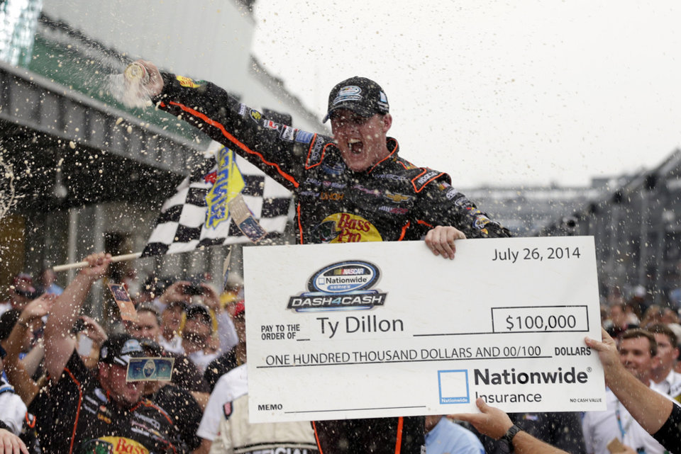 Photo - Ty Dillon celebrates after winning the NASCAR Nationwide series auto race at Indianapolis Motor Speedway in Indianapolis, Saturday, July 26, 2014. (AP Photo/Darron Cummings)