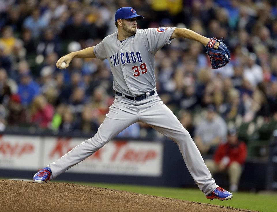 Photo - Chicago Cubs starting pitcher Jason Hammel throws to the Milwaukee Brewers during the first inning of a baseball game on Sunday, April 27, 2014, in Milwaukee. (AP Photo/Jeffrey Phelps)
