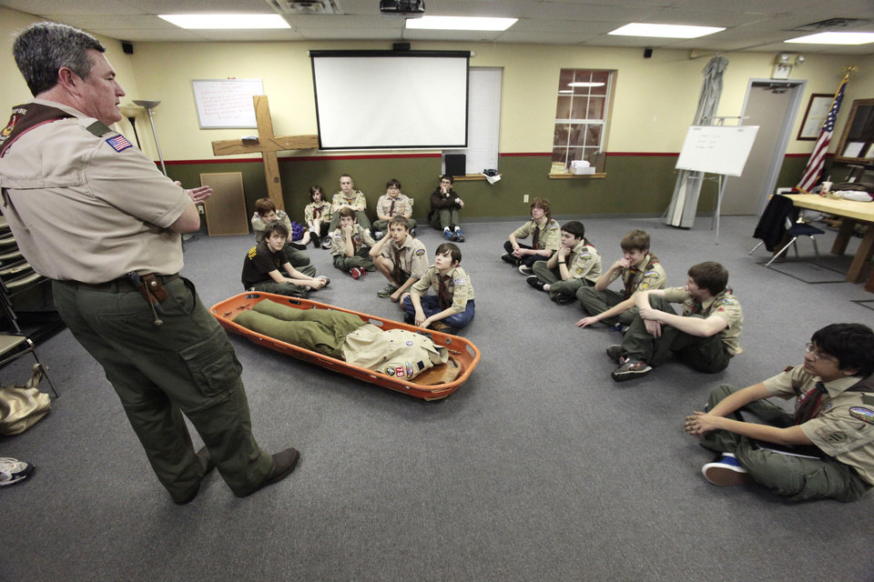 Scouts listen to Scout Master Ron Butts give a search and rescue training lesson during a meeting at St. Mary�s Episcopal Church. Photo By David McDaniel, The Oklahoman