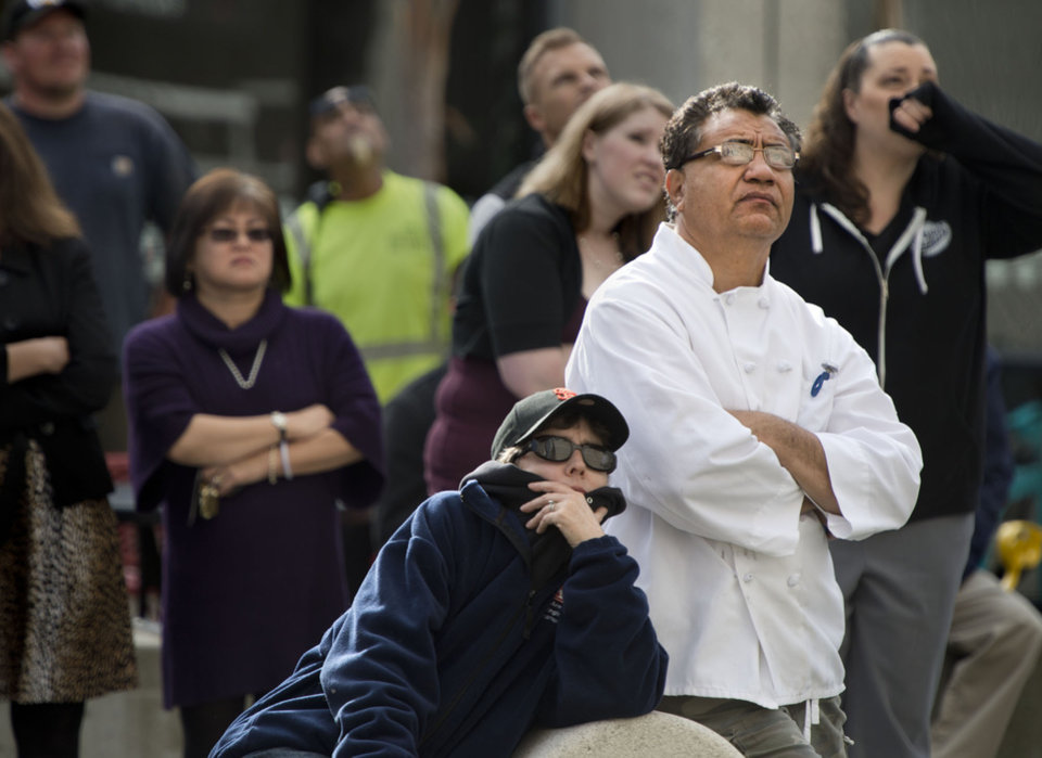 People gather near 13th and J streets to watch firefighters as they recover the body a man hanging from a rope tied to a balcony.   Fire officials said the man's death appears accidental.  (AP Photo/The Sacramento Bee, Randy Pench)  MAGS OUT; LOCAL TV OUT (KCRA3, KXTV10, KOVR13, KUVS19, KMAZ31, KTXL40); MANDATORY CREDIT  (REV-SHARE)