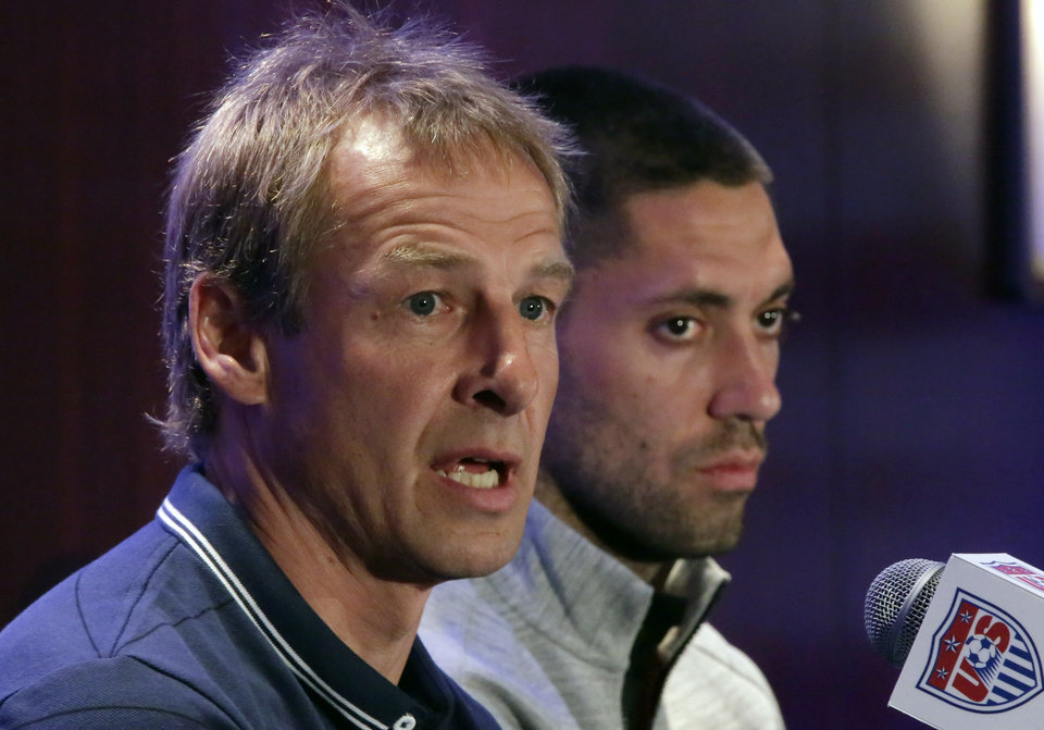 Photo - United States World Cup soccer team coach Jurgen Klinsmann, left, and team captain Clint Dempsey answer questions  during a news conference, in New York, Friday, May 30, 2014. (AP Photo/Richard Drew)