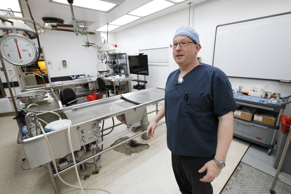 Chief Medical Examiner Eric Pfeifer is shown recently in the autopsy room.  Photo By David McDaniel, The Oklahoman