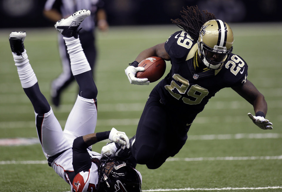 Photo -   New Orleans Saints running back Chris Ivory (29) is tripped by Atlanta Falcons cornerback Dunta Robinson in the second half an NFL football game at Mercedes-Benz Superdome in New Orleans, Sunday, Nov. 11, 2012. (AP Photo/Bill Haber)