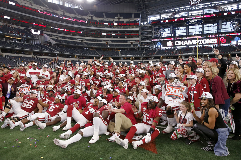 Photo - The Oklahoma football team poses for a photo after the Big 12 Championship Game between the University of Oklahoma Sooners (OU) and the Baylor University Bears at AT&T Stadium in Arlington, Texas, Saturday, Dec. 7, 2019. Oklahoma won 30-23. [Bryan Terry/The Oklahoman]