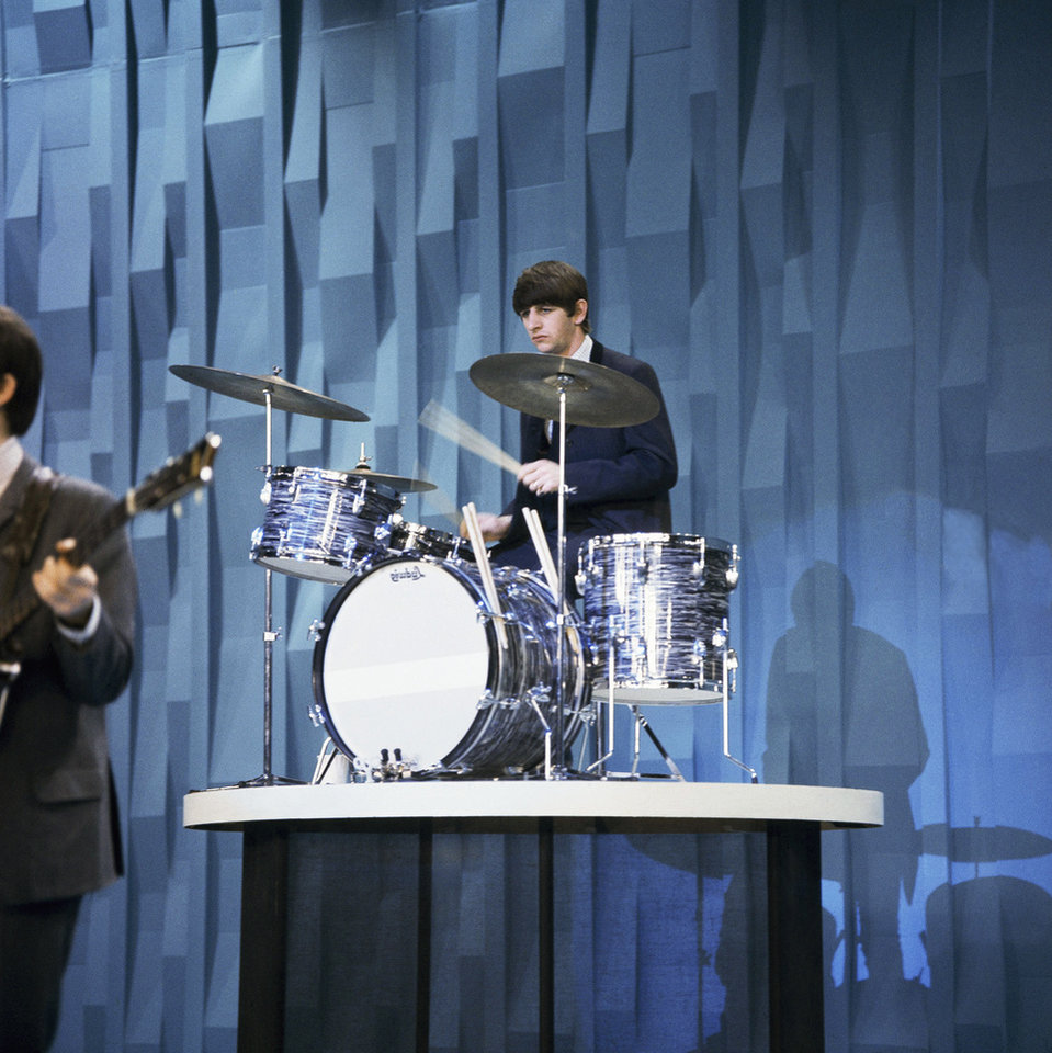Photo - FILE - In this 1964 file photo, the Beatles' Ringo Starr plays drums on the