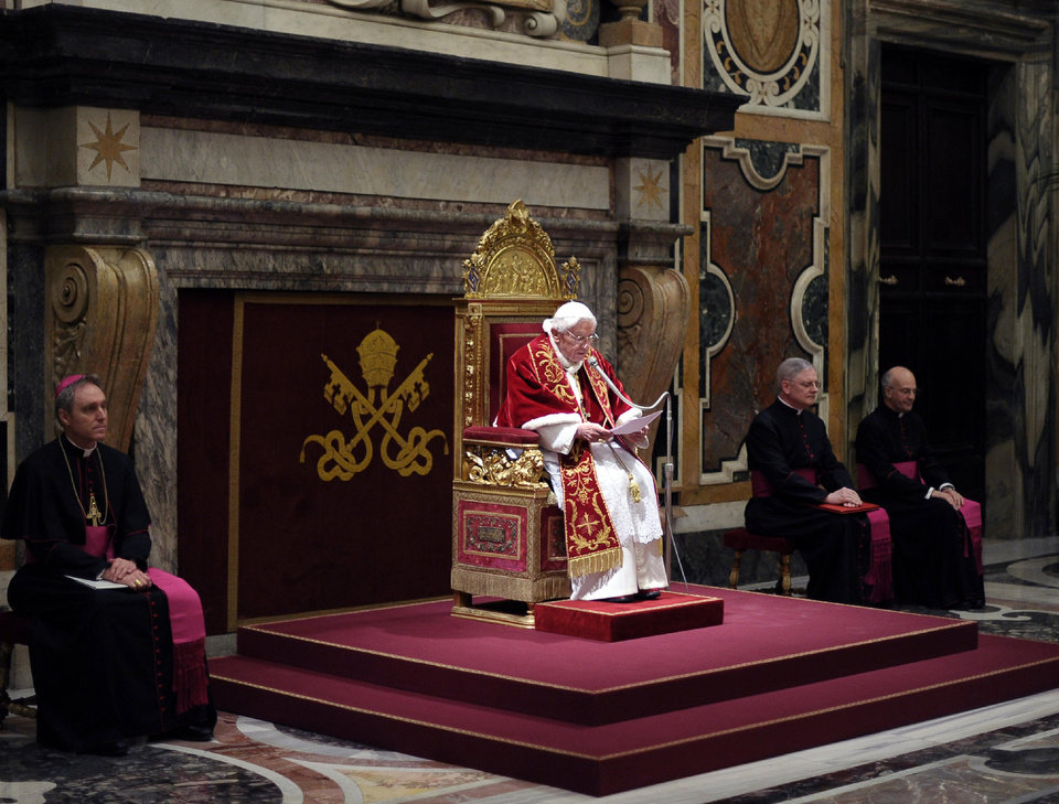 In this photo provided by the Vatican newspaper L\'Osservatore Romano, Pope Benedict XVI, center, delivers his message on the occasion of his farewell meeting to cardinals, at the Vatican, Thursday, Feb. 28, 2013. Benedict XVI promised his