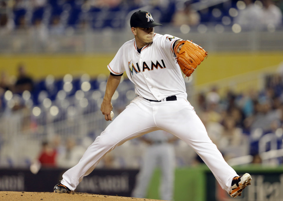 Photo - Miami Marlins starting pitcher Jose Fernandez throws during the first inning of the MLB National League baseball game against the Washington Nationals, Wednesday, April 16, 2014, in Miami. (AP Photo/Lynne Sladky)